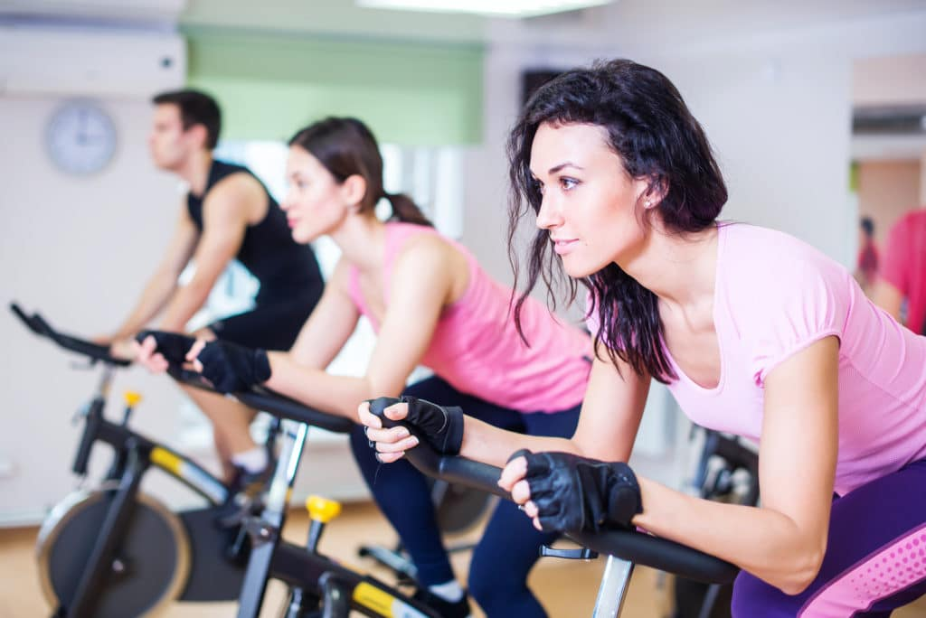 Interval Training- people biking in the gym.
