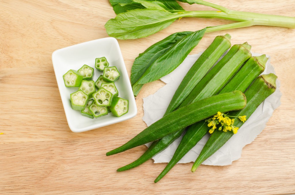 Fresh okra on wooden background,organic vegetables and healthy herb