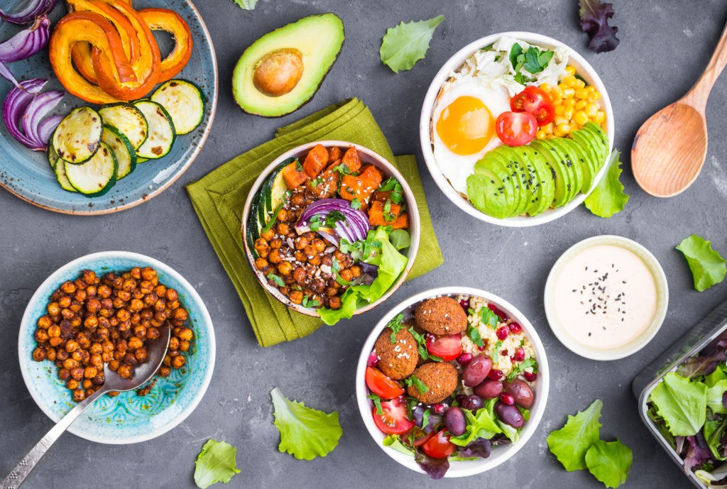 Mixed healthy vegetarian salads with vegetables sweet potato falafel bulgur avocado eggs. Assorted buddha bowl salads. Vegetarian food. Healthy lunch/dinner. Salad in bowl. Ingredients for making